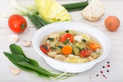 Fresh homemade vegetable soup with ingredients. Healthy eating stock photo
