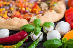 Fresh homemade vegeterian pizza with ingredients, overhead Stock Photos