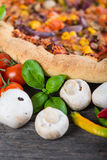 Fresh homemade vegeterian pizza with ingredients, overhead Stock Images