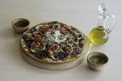 Fresh homemade veggie pizza with vegetables royalty free stock photo