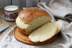 Fresh homemade wheat yeast bread on a linen tablecloth. Rustic style. Fresh homemade wheat yeast bread on a linen tablecloth. Rustic style, selective focus stock photos