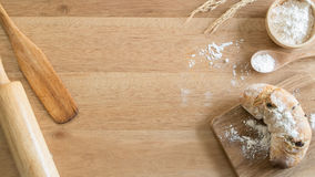 Fresh homemade whole wheat bread on the wooden chopping board Royalty Free Stock Photography