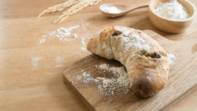 Fresh homemade whole wheat bread on the wooden chopping board Stock Images