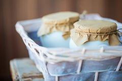 Homemade milk yogurt in jars Stock Images