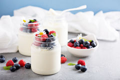 Fresh homemade yogurt in small jars Royalty Free Stock Images