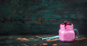 Fresh homemade yogurt smoothie wild wild berries in a glass jar on an old vintage background Royalty Free Stock Photos