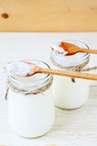 Fresh homemade yogurt, sour cream in jars Royalty Free Stock Photography