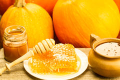 Free Fresh Honey And Drizzler On A Wooden Background. Autumn Style, Honeycomb, Pumpkin Stock Images - 62211524