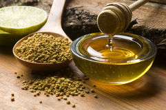Fresh honey and bee pollen stock images