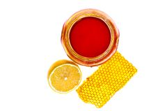 Fresh honey, chamomile and lemon on white isolated background Royalty Free Stock Photos