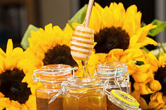 Fresh honey with colorful yellow sunflowers Royalty Free Stock Photos