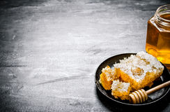 Fresh honey comb in an old pan. Royalty Free Stock Image