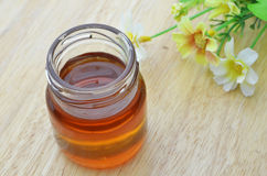 Fresh honey in the glass bank Stock Image
