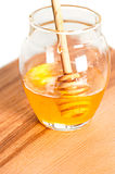 Fresh honey in glass jar. On wooden table. Shallow depth of field Royalty Free Stock Photo
