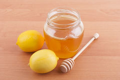 Fresh honey in a glass jar Stock Photos