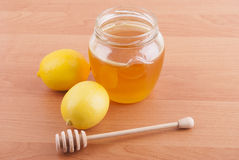 Fresh honey in a glass jar Stock Image