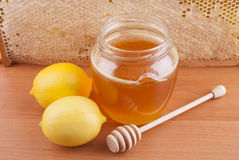 Fresh honey in a glass jar Royalty Free Stock Image