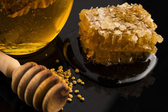 Fresh honey with honeycomb Royalty Free Stock Image