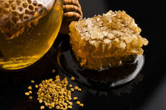 Fresh honey with honeycomb Royalty Free Stock Image