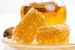 Fresh honey with honeycomb Stock Photo
