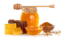 Fresh honey with honeycomb and pollen isolated on white backgrou Stock Photography