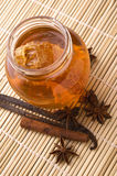 Fresh honey with honeycomb and spices Stock Photo
