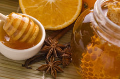 Fresh honey with honeycomb, spices and fruits stock images