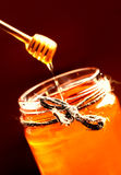 Fresh Honey in jar with honey dipper on vintage wooden backgroun Stock Photos