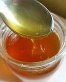 Fresh honey in a jar Stock Photography