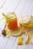 Fresh honey and lemons Stock Image