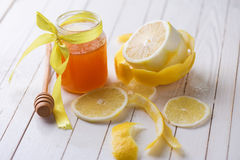 Fresh honey and lemons Stock Image