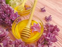 Fresh honey lilac flower on wooden background. Productn stock photo