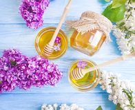 Fresh honey natural healthy  spring heather lilac flower compositionon wooden background. Fresh honey lilac flower  wooden backgroundfresh honey lilac flower on royalty free stock images