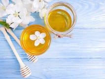 Fresh honey, organic healthy season flavor blooming delicious apple tree, wooden background. Fresh honey organic , blooming apple tree wooden background stock photo