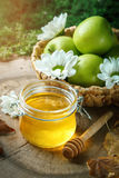 Fresh honey, pollen and ripe apples on a wooden table. Selective focus. Royalty Free Stock Photos