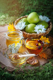 Fresh honey, pollen and ripe apples on a wooden table. Selective focus. Stock Photo