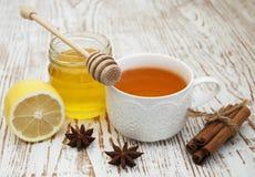 Fresh honey and tea Royalty Free Stock Image