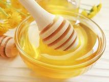 Fresh honey, yellow chrysanthemum flower ingredient on wooden background, summer delicacy. Fresh honey, yellow chrysanthemum flower on wooden background summer royalty free stock images