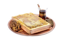 Fresh  honeycombs with honey on plate ,cup of Turkish tea Royalty Free Stock Images