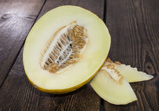 Fresh Honeydew on wood Stock Photo