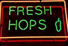 Fresh hops. Neon sign in green and red Royalty Free Stock Images