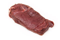 Fresh horse meat steak. Isolated on a white background Royalty Free Stock Photos