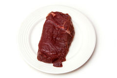 Fresh horse meat steak. Overhead view of a fresh horse meat steak isolated on a white background Royalty Free Stock Image