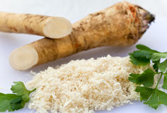 Fresh horseradish with parsley Stock Images