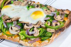 Fresh, hot baked vegetarian flatbread pizza. Stock Photography