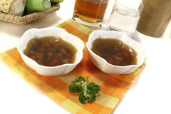 Fresh hot Beef Consomme. On light background Stock Photography