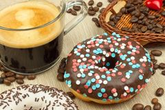 Fresh hot coffee and fresh donuts. Traditional sweets with coffee. Calorie junk food. Fresh unhealthy breakfast. Royalty Free Stock Photos