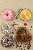 Fresh hot coffee and fresh donuts. Traditional sweets with coffee. Calorie junk food. Fresh unhealthy breakfast. Royalty Free Stock Images
