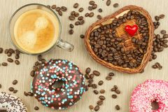 Fresh hot coffee and fresh donuts. Traditional sweets with coffee. Calorie junk food. Fresh unhealthy breakfast. Royalty Free Stock Photography