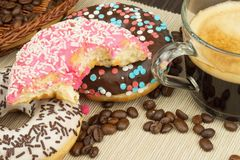Fresh hot coffee and fresh donuts. Traditional sweets with coffee. Calorie junk food. Fresh unhealthy breakfast. Stock Photo